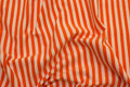 Across-striped, gennemfarvet cotton-jersey in orange and white.