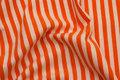 Across-striped, gennemfarvet cotton-jersey in orange and white