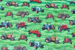 Grass green cotton-jersey with ca. 5 cm tractors