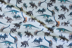 Grey cotton-jersey with 2-4 cm dinosaurs
