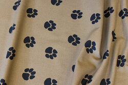 Medium-thickness cotton-canvas dirt-colored with ca. 3 cm black paws