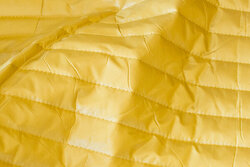 Smooth quilt in light brass-yellow with lining-back