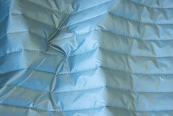 Smooth quilt in light petrol with lining-back