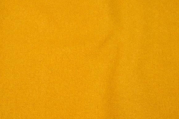100% wool bouclé in brass-yellow