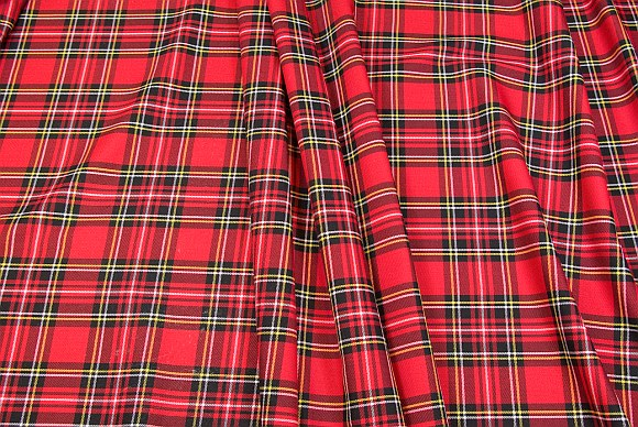 Tartan checker fabric in red, black, white and yellow