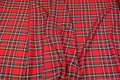 This tartan fabric is of a light quality with a strong red base and green and yellow lines. Rectangular areas are ca. 12 cm diameter.