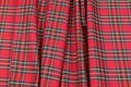 This tartan checker fabric is of a light quality with a strong red base color and blue and yellow lines. Rectangular areas are ca. 7 cm diameter.