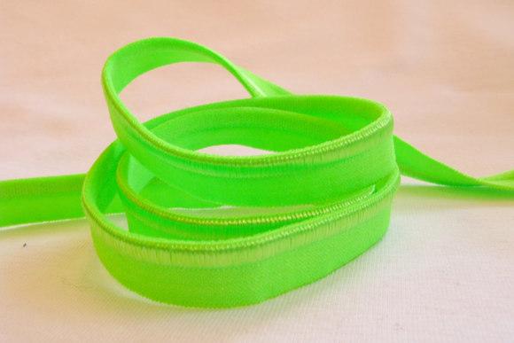 Elastic piping, flourescent green