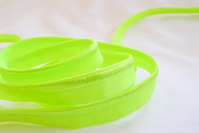 Elastic piping, flourescent yellow/green.