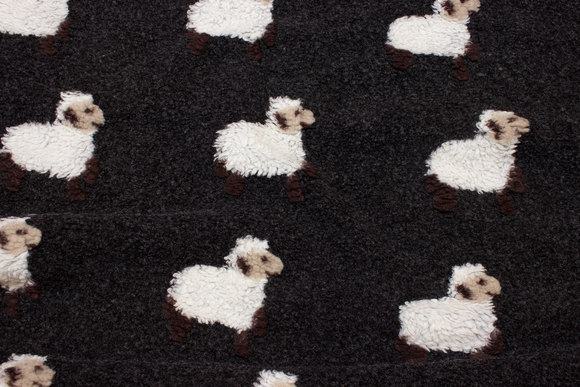Dark grey-brown bouclé-fleece with felted sheep