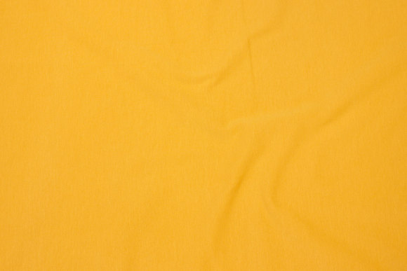 Cotton-jersey in brass-yellow
