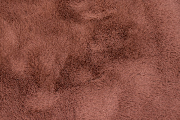 Supersoft fake-fur in cafè latte colored with soft red hue