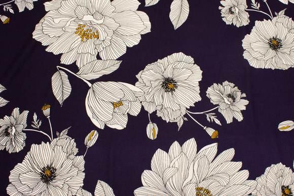Navy, lightweight polyester crepejersey with big white flowers.