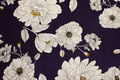 Navy, lightweight polyester crepejersey with big white flowers..