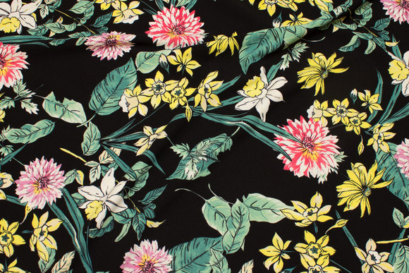 Stretch crepe jersey in black with soft red, yellow and green flowers