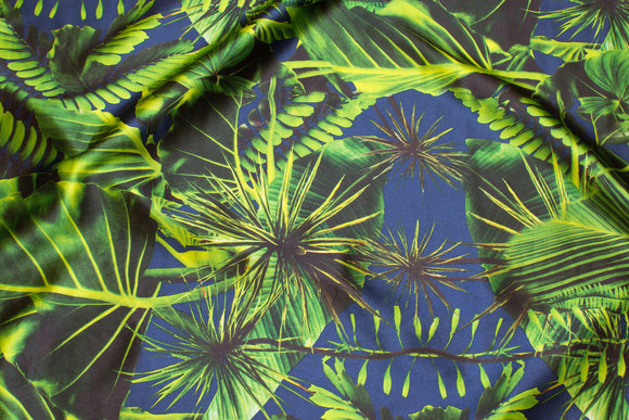 Stretch-satin in light navy with green jungle leaves