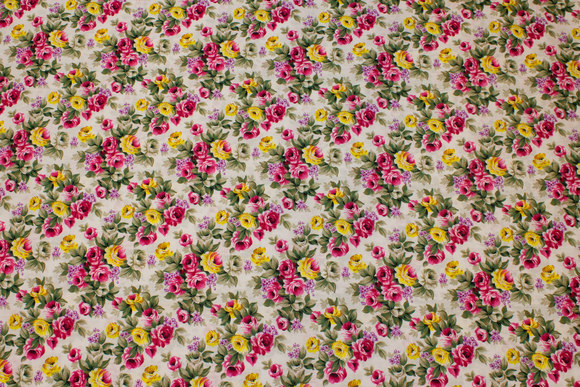 White cotton with pink and yellow roses
