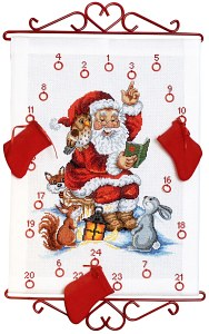White Christmas calendar with Santa Claus reading. Permin 34-2525.