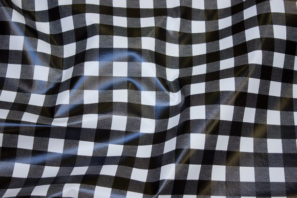 Black-white coated fabric with beautiful checks of 1½ cm
