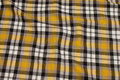 Checked winter-cotton in yellow, black and grey.