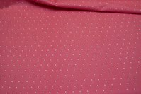 Coral-color cotton with small white and sand-colored dots