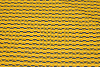 Cotton in brass-yellow and navy retro-pattern