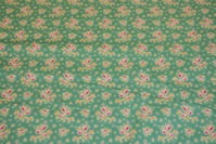 Jade-green cotton with small soft red flowers