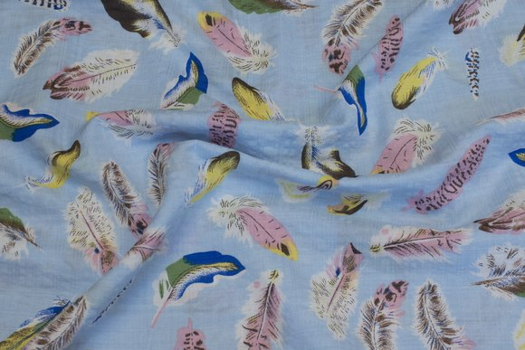 Lightweight blouse-fabric, light blue with feather-motif