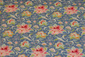 Medium-blue cotton with soft red flowers.