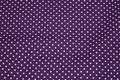Purple cotton with dots.