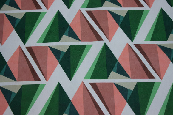 Rugged cotton in off white with graphical pattern in green and coral
