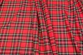 Tartan checker fabric in red, black, white and yellow.