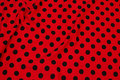 Red cotton-jersey with 16 mm black dots.