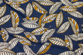 Dusty blue viscose-jersey with leaves in white and yellow.