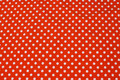 Orange cotton-jersey with white 8 mm dots