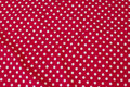 Red cotton-jersey with white 8 mm dots.