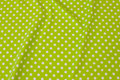 Lime-green cotton-jersey with white 8 mm dots .