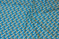 Turqoise viscose-jersey with small circle-pattern in blue and white and beige
