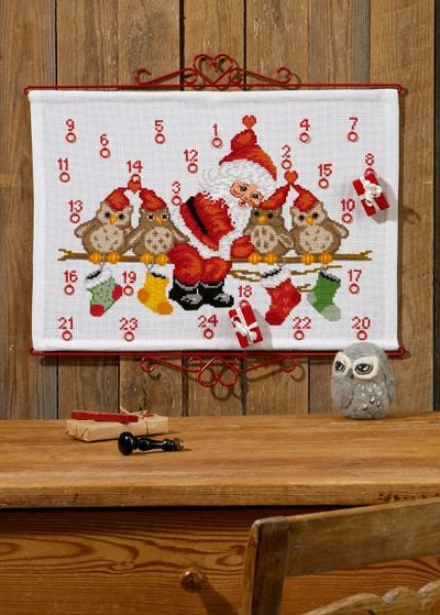 Christmas calendar with owls on branch