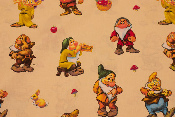 Creme-colored cotton with the seven dwarfs.