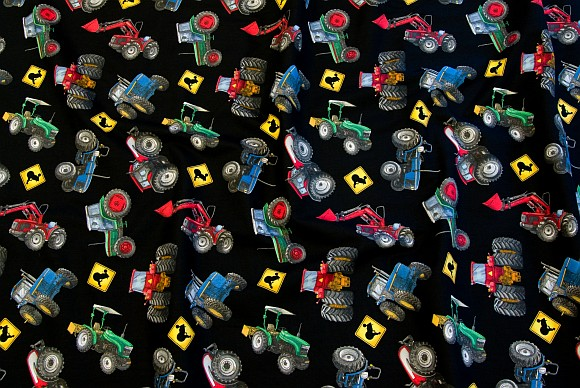 Black cotton with cool colored tractors