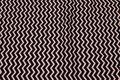 Black cotton with white zig zag stripes .