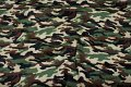 Camouflage fabric in green, black and brown