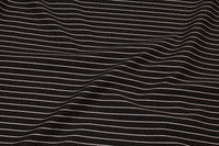 Charcoal heavyjersey with light stripes along length of fabric
