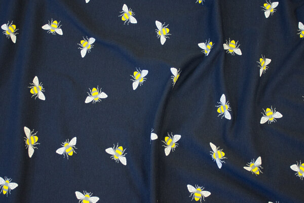 Cotton-jersey in dark navy with 3 cm bees