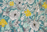 Cotton-jersey with flowers in mint, petrol, white and yellow