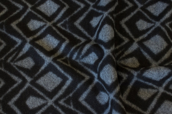 Firm, felt knit in black and grey domino pattern