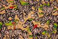 Fun beige patchwork cotton with lots of zebras