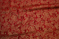 Gold print on red patchwork-cotton