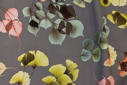 Grey viscose mousselin with coral and lime leaves